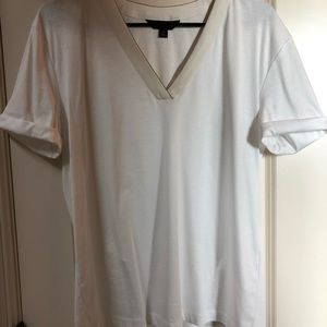 White tee, dressy with gold outline around neck.